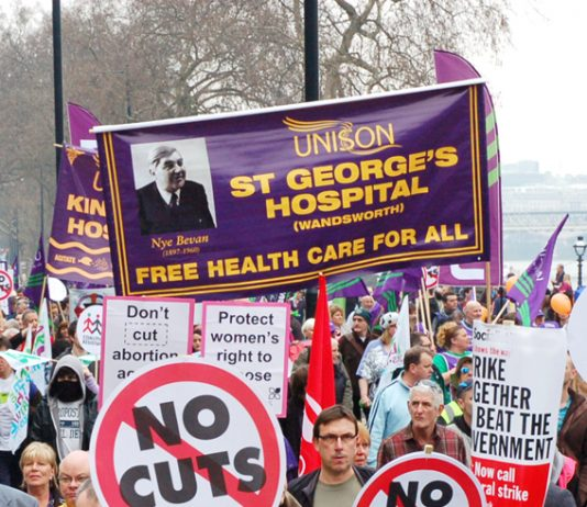 Trade union banners and placards demanding defence of the NHS and no cuts – these will be key demands on May Day