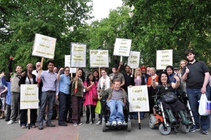 Lively contingents from Tower Hamlets with the Disability Coalition and Disability Information Training