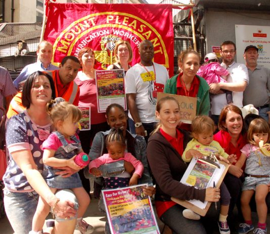 'Keep Our Nursery Open', demanded protesting postal workers outside Mount Pleasant Mail Centre yesterday lunchtime