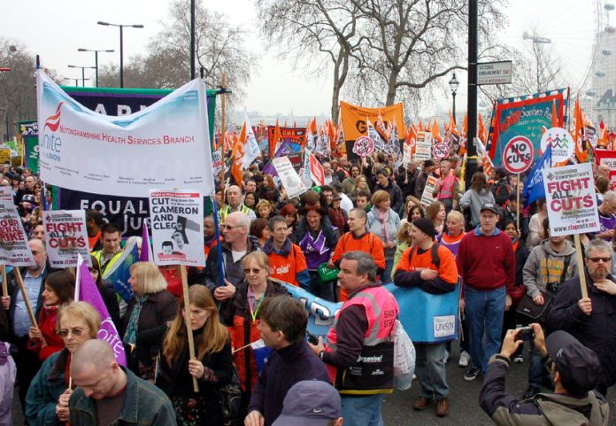 Union banners from Unite and the GMB on the 500,000-strong TUC demonstration against cuts on March 26