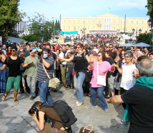 Victorious dancing in the square in front of the Vouli as the Papandreou government falls