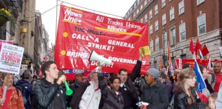 The News Line-All Trades Union Alliance banner on the March 26th 500,000-strong TUC demonstration against cuts
