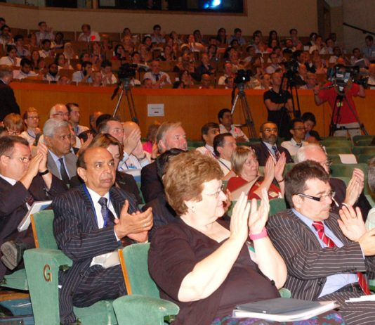 Delegates applaud at the BMA's ARM on Monday as doctors condemned cuts to the NHS