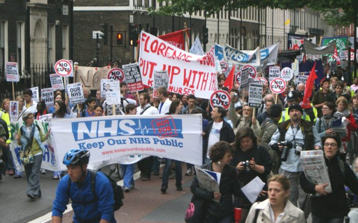 Campaigners marching from University College Hospital to the Department of Health in May demanding that NHS privatisation be stopped