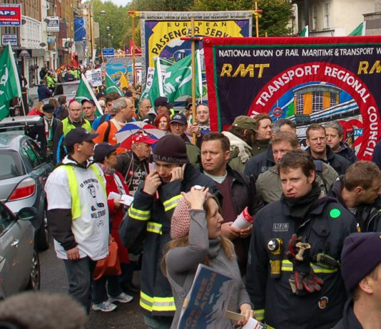 RMT rail union members marching against government cuts and in defence of jobs