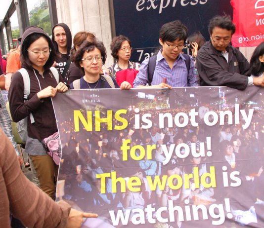 Korean health advocates took part in the march with their banner to show that the defence of the NHS is not just a national issue