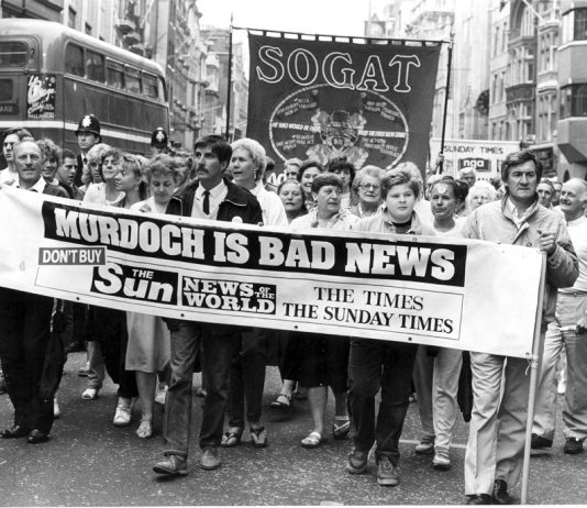 Sacked News International print workers marching in Fleet Street with a defiant message during their bitter 1986-87 strike