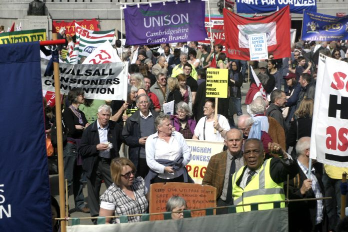 Pensioners and trade unionists at a Trafalgar Square rally. They are determined to defend all public services