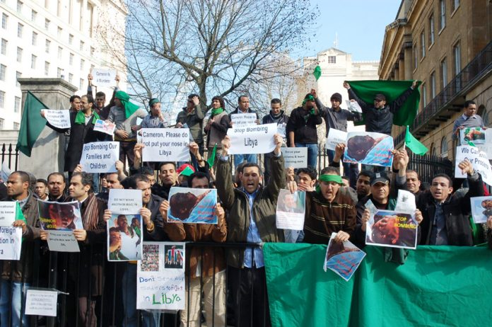 Libyan students and workers picketing Downing Street demanding the coalition stop the bombing of the Libyan people