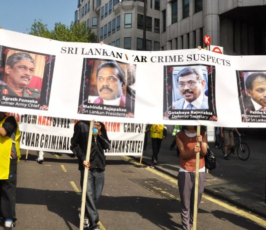 Tamils marching on May Day in London condemn Sri Lankan President Rajapaksa and his brother as war criminals