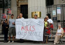 The picket line at Bush House. Howard Zhang (centre) told News Line 'They are forcing people out who don't want to go.'
