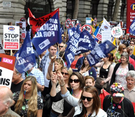 Members of ATL, NUT, UCU and PCS marching in London during their national strike action to defend pensions on June 30
