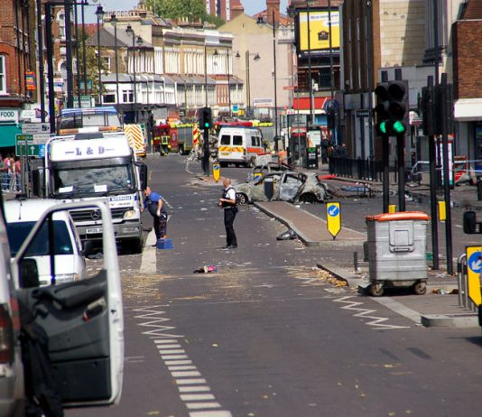Police have sealed off a major section of the Tottenham High Road in the wake of Saturday's uprising