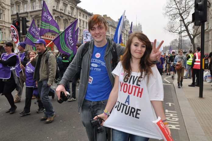Young workers marching against the Tory-LibDem coalition. Mass sackings and cuts to services are causing mass unemployment