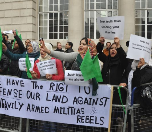 Libyans demonstrating in London to condemn the NATO bombing of Tripoli and NATO support for the counter-revolutionary 'rebels'