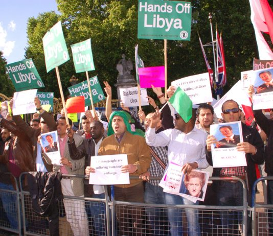 Libyan students demonstrate against the NATO bombing of Tripoli during US President Obama's visit to Buckingham Palace in May