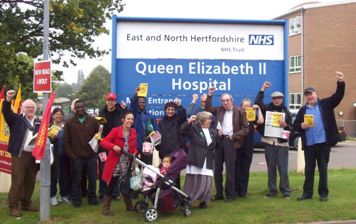 Welwyn and Hatfield Keep NHS Public campaigners with supporters from the North East London Council of Action picket to demand the QEII Hospital be kept open