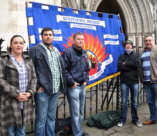 FBU members with their banner outside the High Court in London yesterday morning