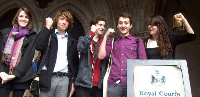 Callum Hurley and Katy Moore and supporters challenging the government over tuition fee rises yesterday at the High Court