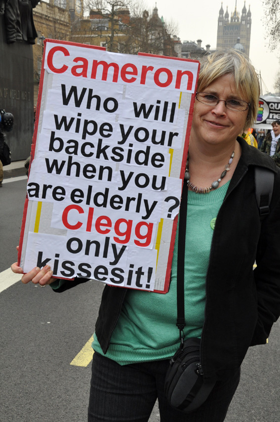 A demonstrator in London in March condemns the coalition's savage cuts to services