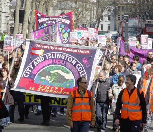 Students march alongside their lecturers on the UCU strike on March 24 this year