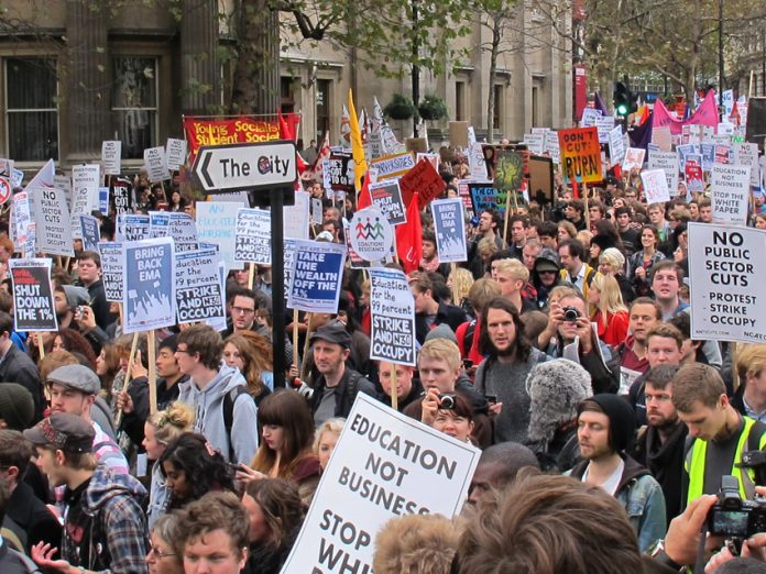 A section of the 10,000-strong student march as it approached Trafalgar Square yesterday