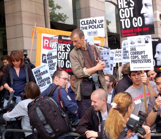 Protesters outside the Culture Committee in July as Rupert Murdoch appeared