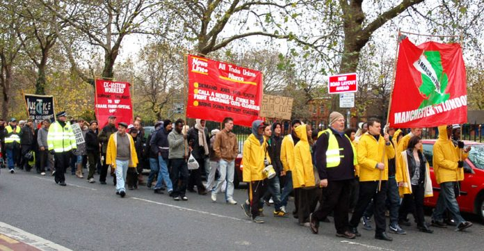 Young Socialists marching through east London to last year's News Line Anniversary on November 21. They had marched from  Manchester to London demanding jobs for youth and warning workers that the only way to deal with the Tory-led coalition was to bring