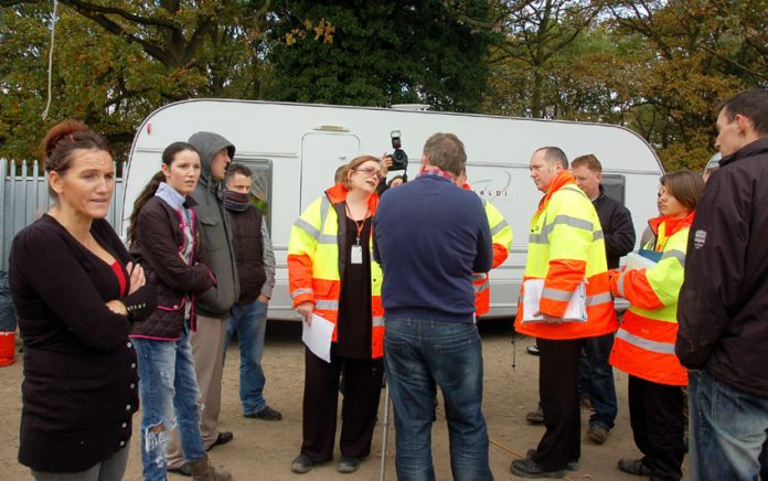 Residents confront council officers with their eviction orders on Wednesday