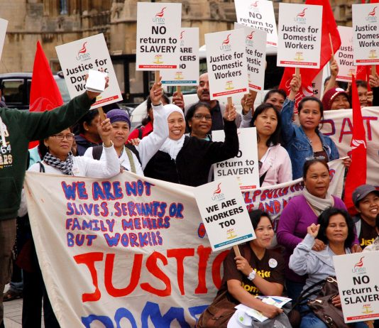 Domestic workers demonstrating outside Parliament demanding 'No return to slavery'