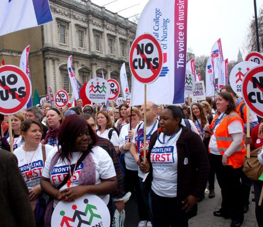 Members of the Royal College of Nursing marching on the TUC's national demonstration on March 26