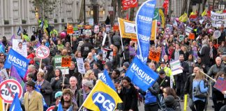 A section of London's 50,000-strong march with PCS and NASUWT flags