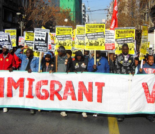 Immigrant workers marching in Athens during Thursday's one-day strike