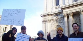 A group of Occupy London campaigners outside St Paul's Cathedral before their peace walk to Westminster