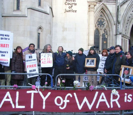 Demonstrators outside the High Court show their support for Julian Assange