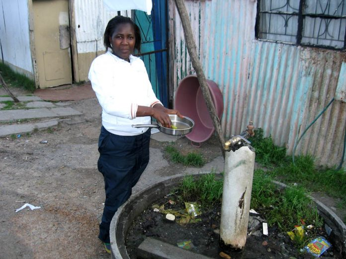 A stand-up tap is the only washing facility for thousands of South Africans
