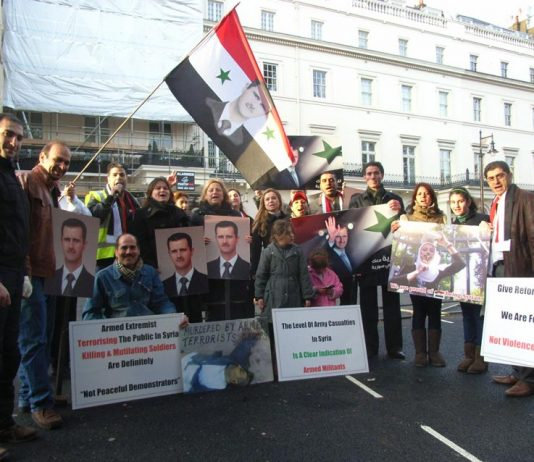 Syrians outside their embassy in London show their support for President Assad and condemn imperialist intervention