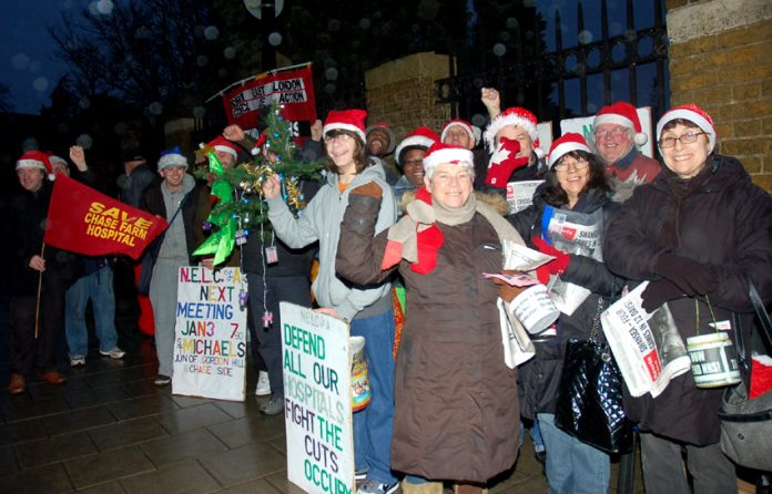 A strong early morning picket adds the Christmas spirit to its determination that Chase Farm Hospital must not be allowed to close
