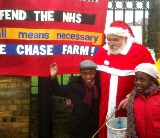 'Father Christmas' with Ethan and Larah Otoo on the picket line at Chase Farm Hospital where both the children were born