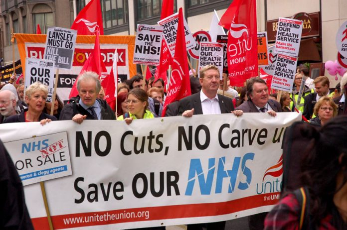 Trade unionists and youth marching to defend the NHS last July – now all unions are agreed that the health bill must be stopped
