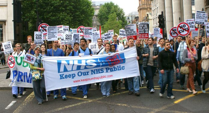 Hospital workers marching last May against the sell-off of NHS services