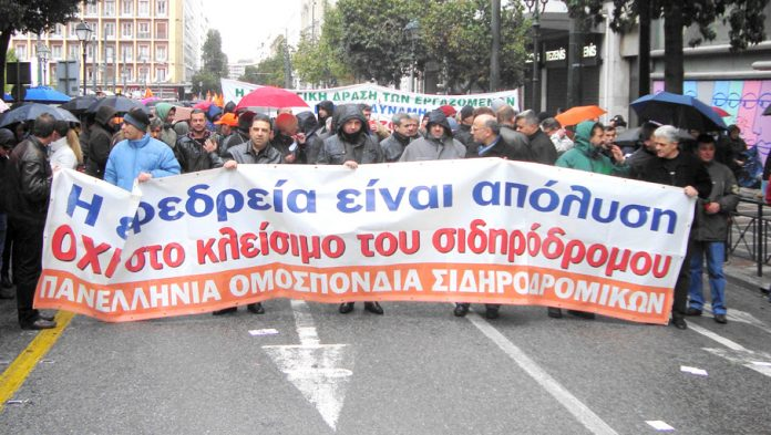 Rail workers marching during Tuesday's general strike in Athens