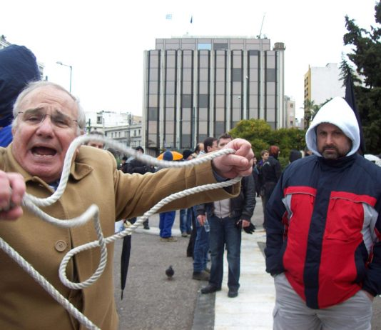 Worker showing the noose he wants to use on the bankers  during a demonstration last Thursday in Athens