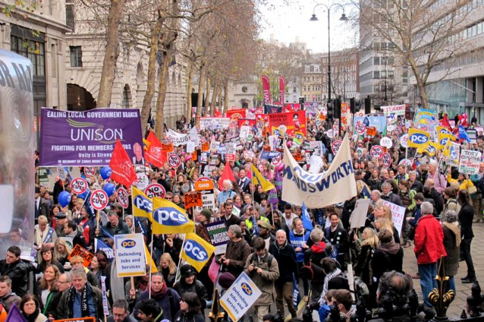 Local government workers marching in London during their strike action last November 30