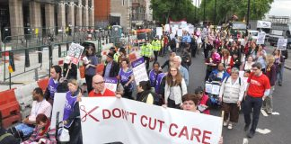 Carers marching against wage and services cuts last year