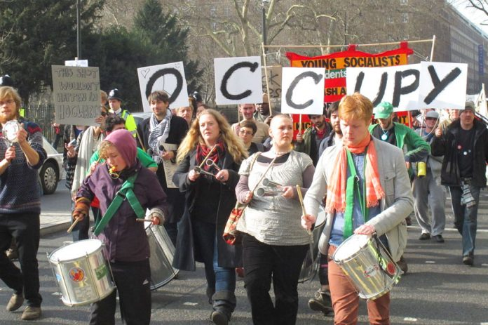 A section of yesterday's march by students demanding free state education and condemning the £9,000 fees for students and the coalition's huge education cuts