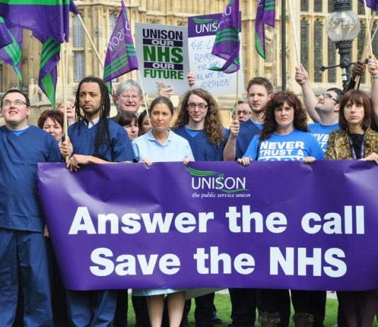 Unison members outside Parliament yesterday afternoon showing their determination to save the NHS
