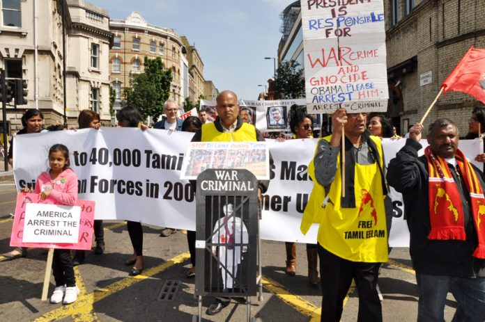 Tamils marching on the London May Day demonstration last year demanding action against Sri Lankan war criminals