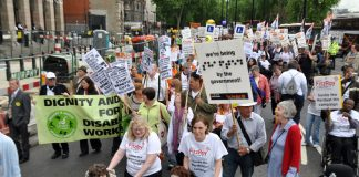 Disabled people march against cuts to the Disability Living Allowance