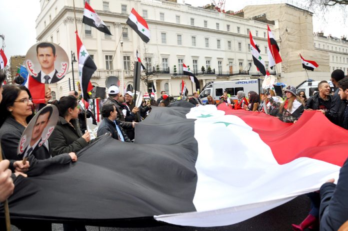 Syrians in London defending their country against the onslaught by imperialism